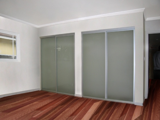 frosted glass with silver aluminum frames hmmm possible sliding bathroom door