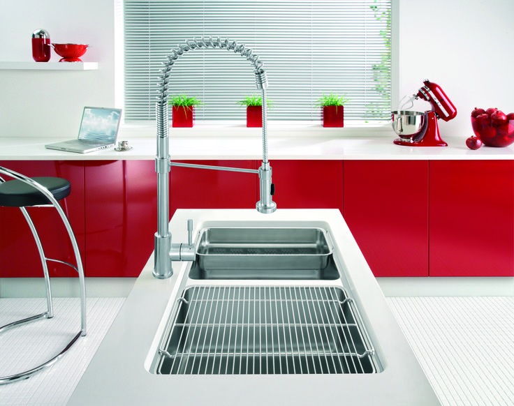 This Franke tap adds a focal point to this modern red kitchen