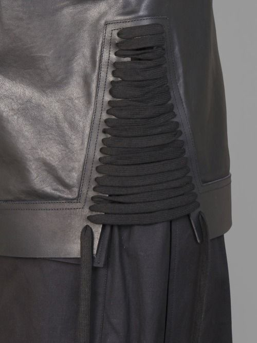 Black leather top with lace-up sides; close up fashion detail; pattern cutting; sewing inspiration