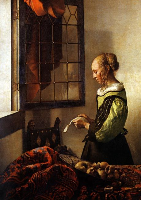 A Girl Reading a Letter by Jan Vermeer. Look at the reflection on the window, that is so incredible. That is one reason that Vermeer is a true master.