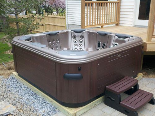 Installing Hot Tubs: We installed this spa on the ground level next to an existing paver patio; this position also gave direct access to spa from an existing raised wood deck which leads directly to the back door.   More: http://www.longislandhottub.com/longisland_hot_tub_spa_blog/?p=1491    The Magic of a Portable Spa Patio or Spa Deck