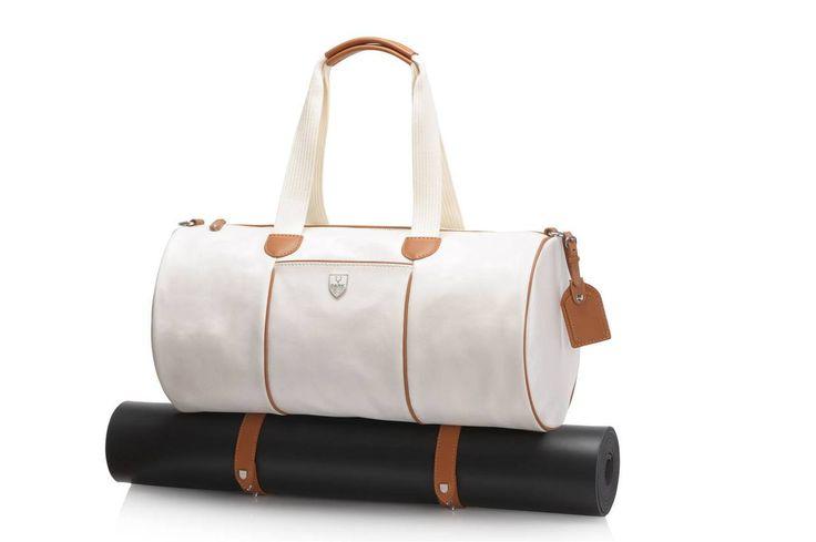 Slam Glam - Park Luxury White Sudbury Ladies Gym Duffel Bag, $495.00 (http://www.slamglam.com/park-luxury-white-sudbury-ladies-gym-duffel-bag/) NEW!  Beautiful duffel gym bag with adjustable straps to carry your yoga mat.   #parkluxurybags #duffelbags #yogabags
