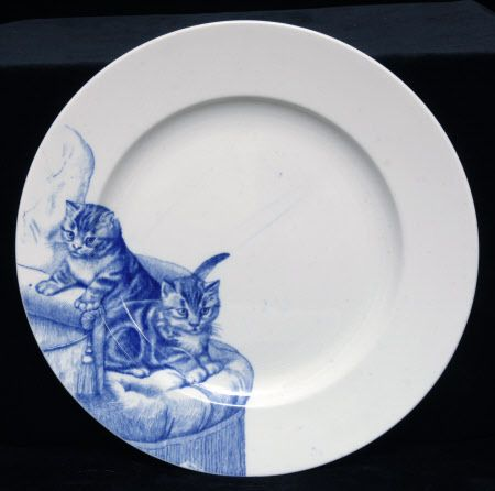 One of twelve circular plates, each decorated with a different image of cats. Kingston Lacy © National Trust / Simon Harris
