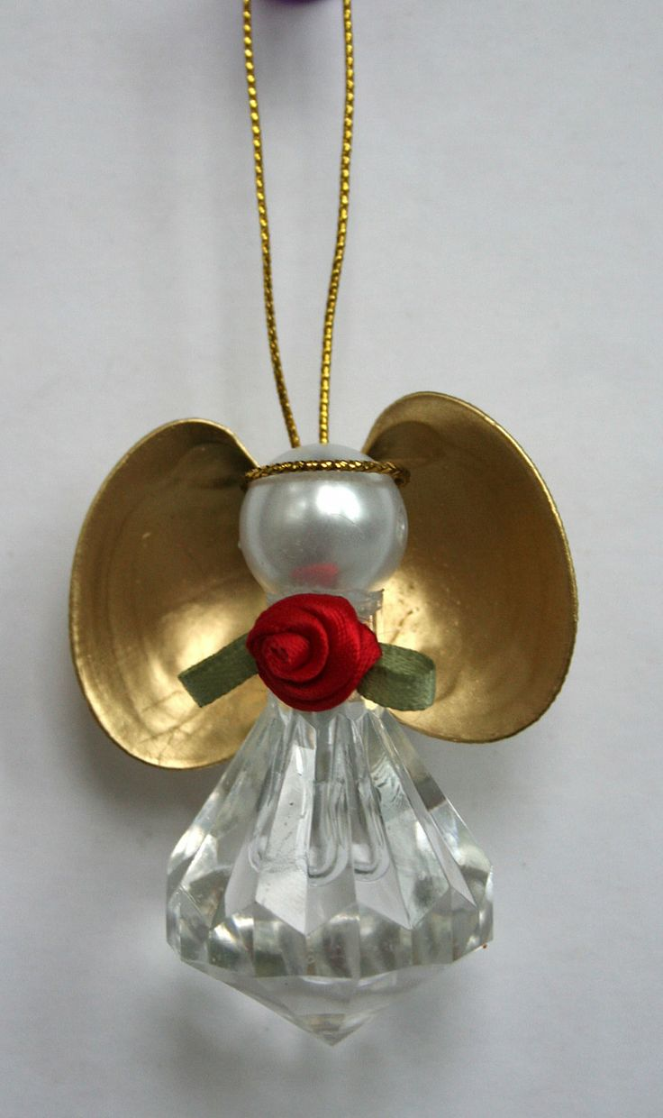 Angel ornament crystal body gold clam shell wings pearl