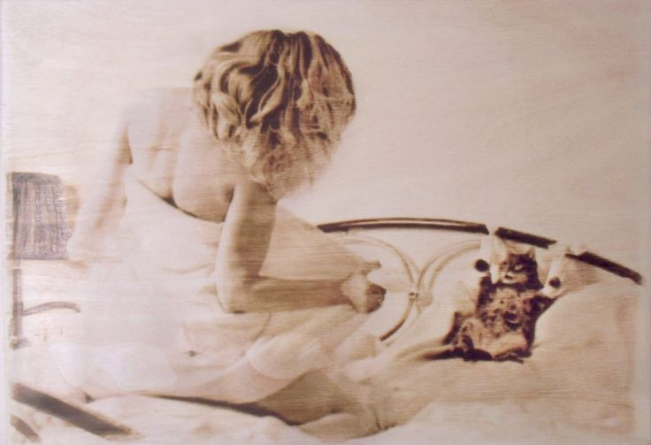 Pyrography by me - Woman and the cat =)  Watch more artworks on http://pyroprint.com/pyrography-by-me/