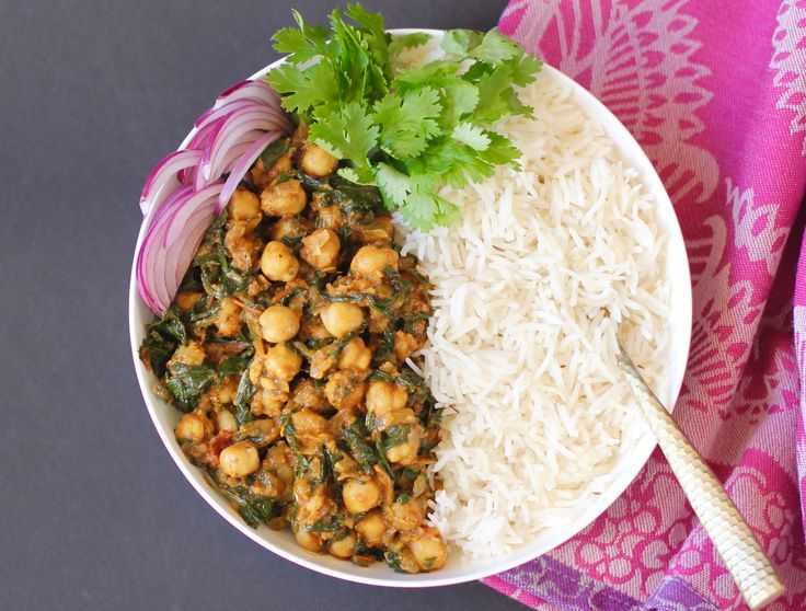 Chana Saag - Vegan, chickpeas and spinach dish cooked in onion, tomato based tangy sauce and spiced with turmeric, cumin and garam masala.