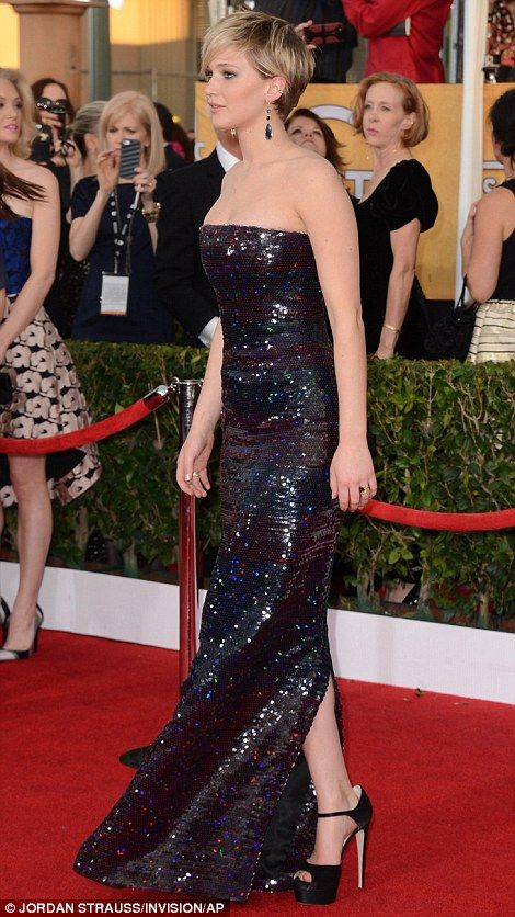 Jennifer Lawrence smoking hot in her strapless shiny sequinned gown and black satin peep-toe sky high platforms, which showed off her gams