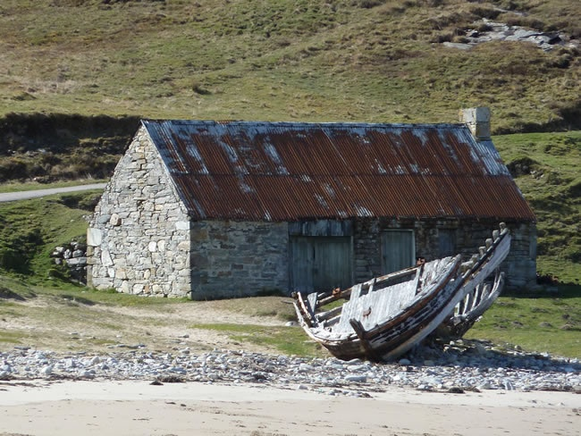 Boathouse and wooden boat wreck