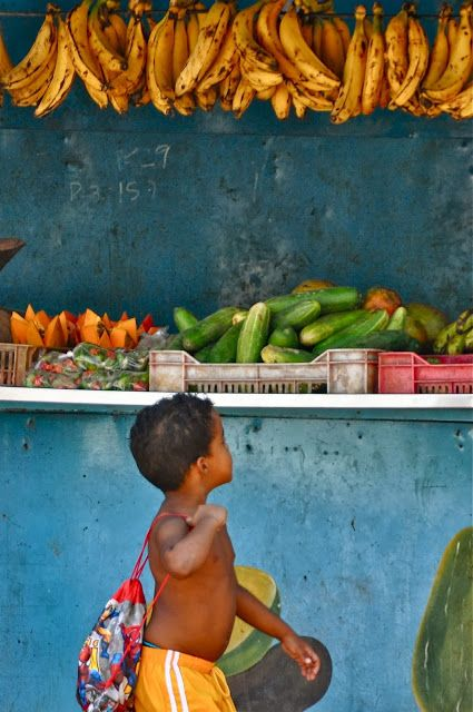 too bad that little sack of food is all he can take home =O(  ... Little man Shopping the market in Cuba, la Havane