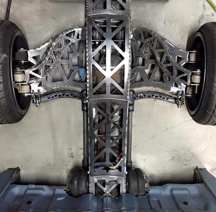 Amazing metal work on this custom chassis sporting an irs for Suspension metal