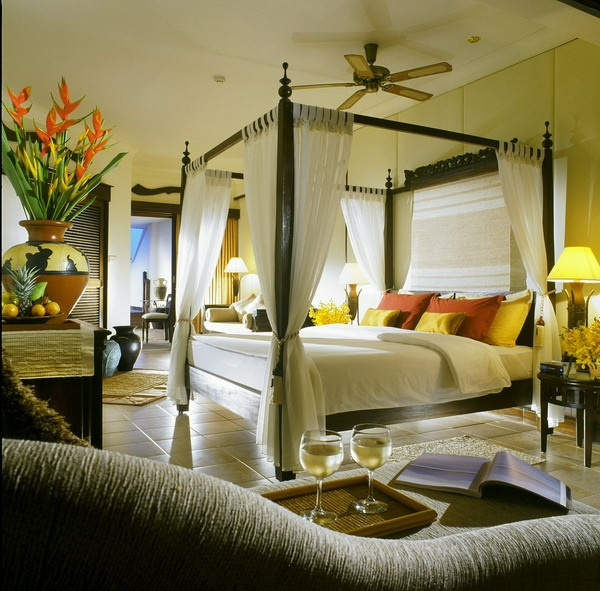 Tropical flowers like ginger and bird of paradise (even if they're fake) will add a sense of paradise to the room.