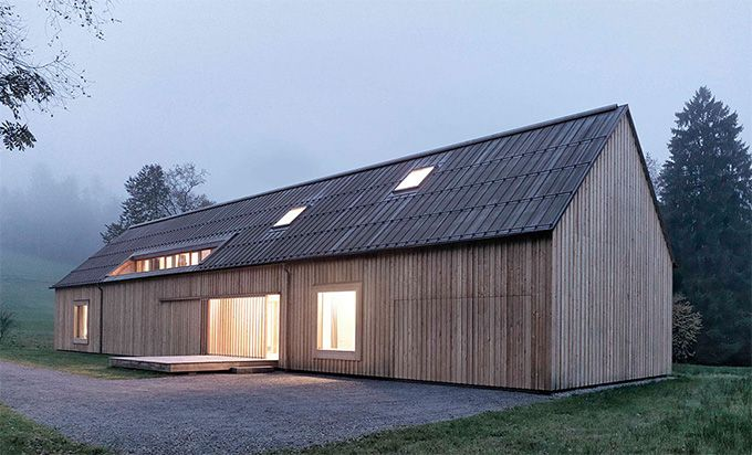 Haus am Moor - Austria For some of us, the exterior of the house brings back images of Scandinavian barns in their hulking, windowless, untreated beauty that weathers perfectly in the harsh climate till the barns appear to be part of the landscape.
