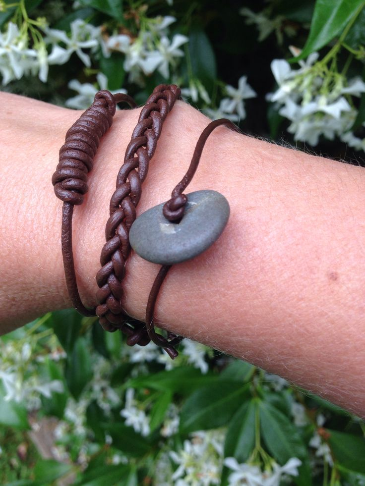 Drilled beach stone and leather bracelets.