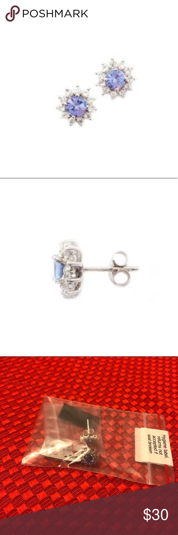 NWT! Tanzanite Earrings w/White Topaz in SS NWT! Tanzanite Earrings with White Topaz set in Sterling Silver, 1.58cts  2 gems AA clarity Tanzanite, .98cts 22 gems White Topaz, 0.60cts    Check out the other listings in my closet and bundle to save! Offers welcome🌸 Jewelry Earrings