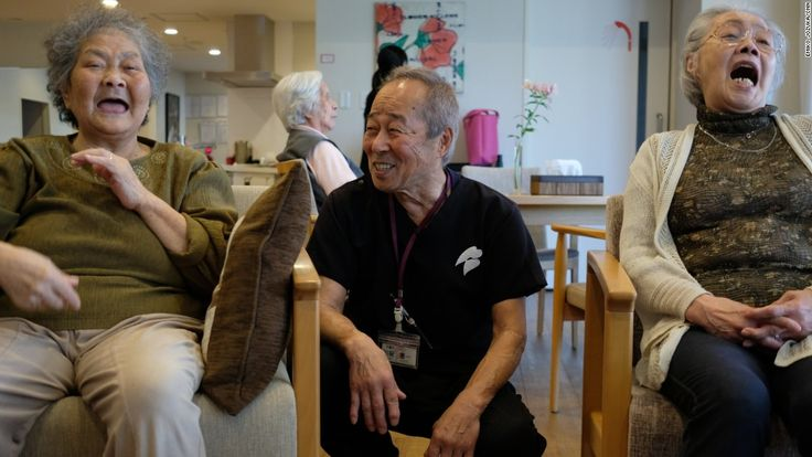 In a elementary school turned nursing home, Tasaka Keichi jokes with a group of cheerful old women.