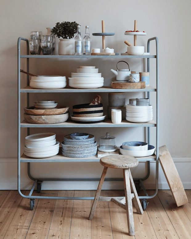 Industrial trolley storage in the kitchen of a light and airy Danish home. Hubsch.