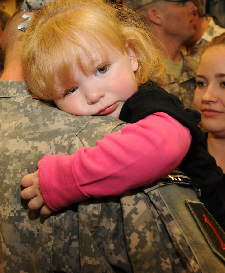 """Abigail Castro, a 21-month-old, clings to her daddy, Spc. Kory Castro, following his return to Fort Riley, Kan., Oct. 21. Spc. Castro, assigned to 1st Battalion, 7th Field Artillery Regiment, 2nd Heavy Brigade Combat Team, was one of more than 250 Soldiers of 1st Infantry Division, who returned from a 12-month deployment to Iraq as part of the Dagger brigade's first """"main body"""" flight. The remainder of the brigade's 3,000 Soldiers will return to Fort Riley throughout the next several weeks. Photo by Mollie MillerBlessed America, American Heroes, Daddys Girl, God Blessed, Military Moments, Usa, Soldiers Child, Daddy Girls, American Soldiers"""