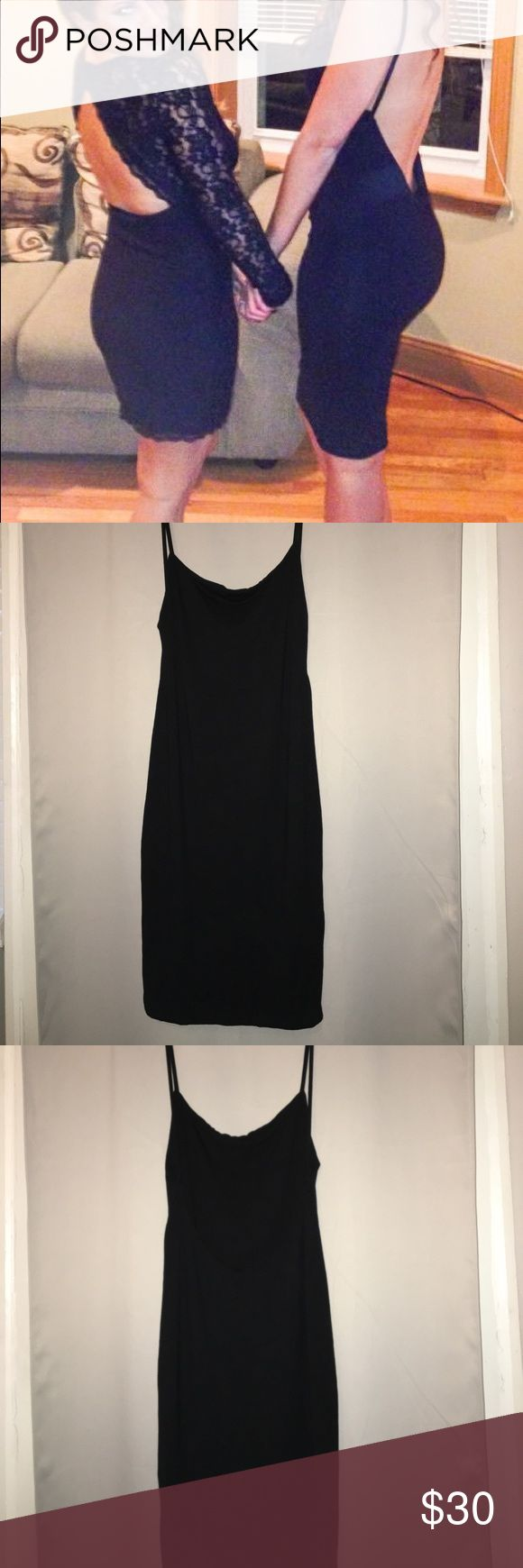 Missguided black dress Missguided open back black dress. Double lined. One of my favorites! Perfect for a wedding, New Years or date night! Worn once! Size says 12 but I'm 5'7, 135 lbs and it fits PERFECT! I typically wear sizes 4/6. Missguided Dresses Midi