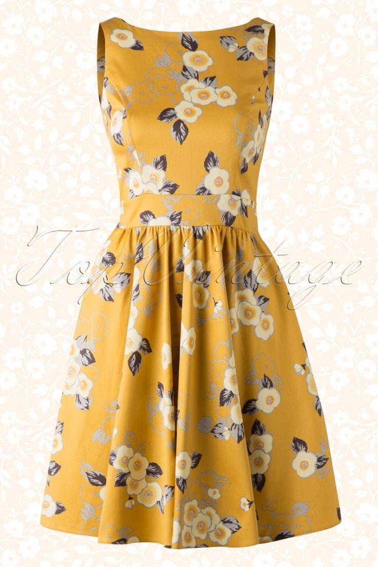 Lok de zon achter de wolken vandaan met deze 50s Floral Tea Dress!Fresh, flirty en feminine dankzij haar ronde halslijn, subtiele V rug en vaste strikbanden voor een vrouwelijk fifties silhouet, wow!