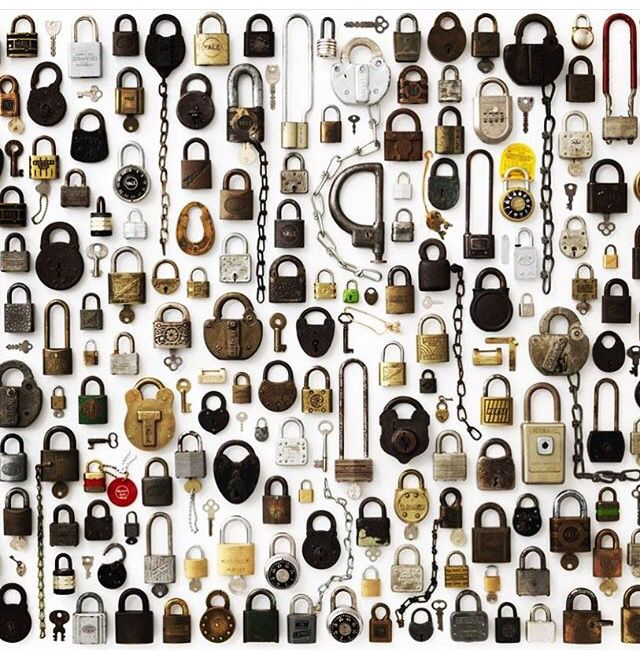 Collection of antique padlocks and keys.