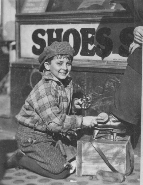 Lewis Hine, c. 1930, 10-year-old  shoeboy.  (at least it looks as if this young fella has shoes on his feet - musta been a good week or something.)