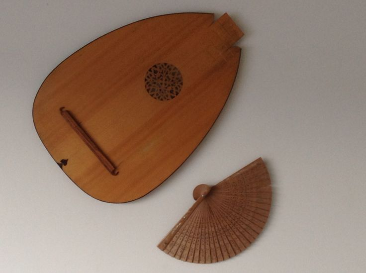 Lute rosette with fan! Belly badly cracked and needed to be replaced. It now adorns our wall.