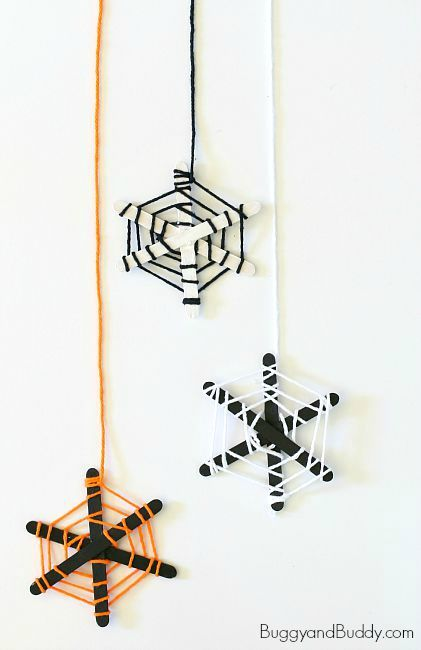 Popsicle Stick Crafts: Make a popsicle stick and yarn spiderweb craft with the kids for Halloween!