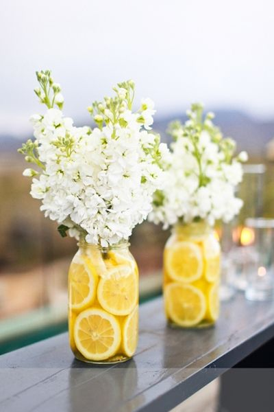 absolutely love lemons/yellow/mason jars/this fun way to add color to center pieces! So pretty and creative.
