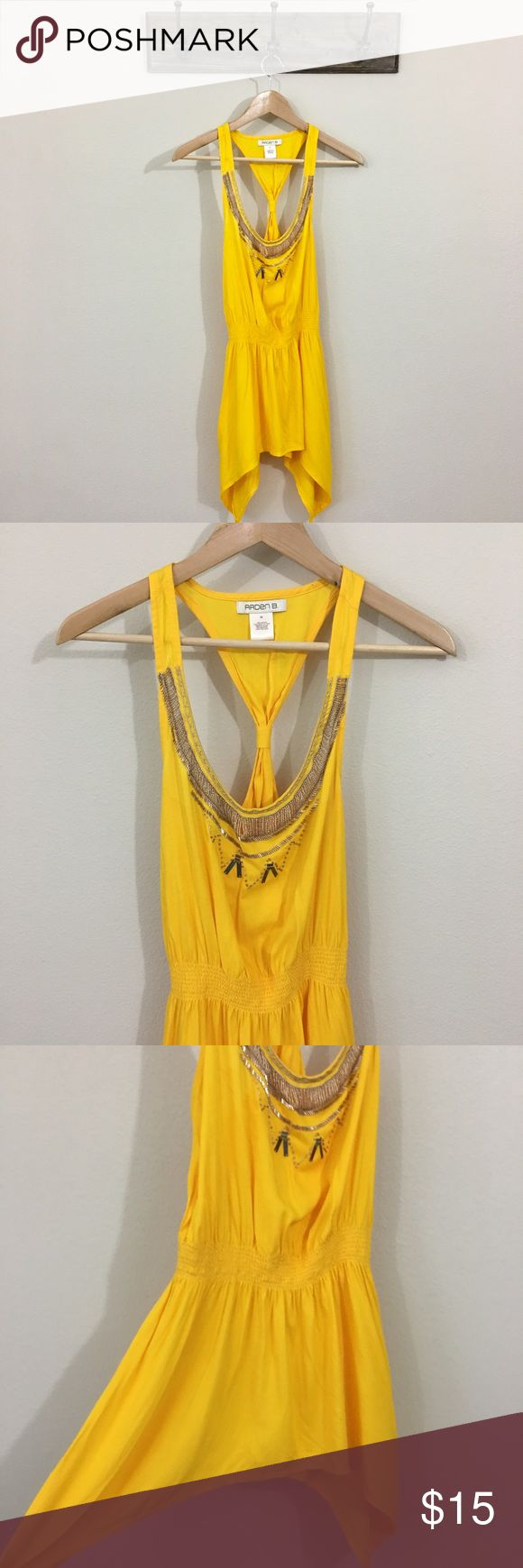 Arden B. Tank Top Bright yellow racerback tank top, perfect for a summer night night, or a pop of color underneath a blazer. Asymmetrical length on the sides makes for a flattering flowy look with the fabric. Silvery sequin embellishment along the neck line. Arden B Tops Tank Tops
