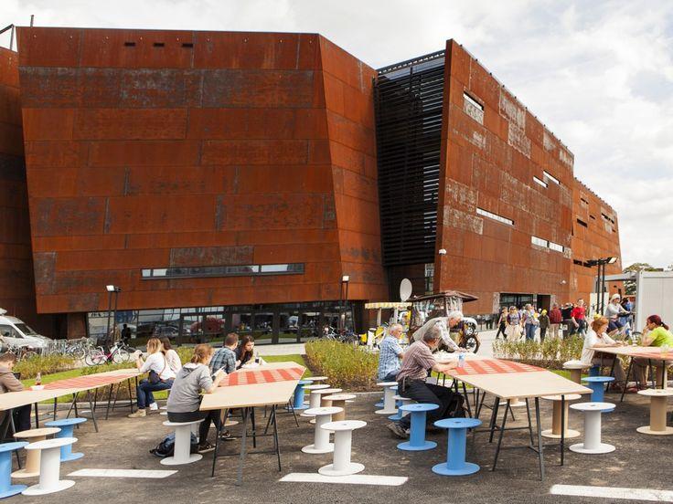 ECS' opening 2014 / Big urban asimetric tables with industrial reels as stools / fot. szajewski.com