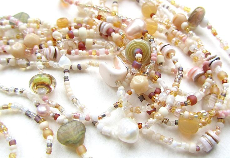 Was ever anything more evocative of sand and shells? I can't wait for it to be summertime again! Tiny lampwork beads are 'little wishes' by Tan Grey