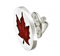 Maple Leaf Pin.  These engraved maple leaf pins on a rhodium plated silver background are a sophisticated. Size: 19mm round (3/4 inch round). http://www.stunningselection.com/maple-leaf-pin-486