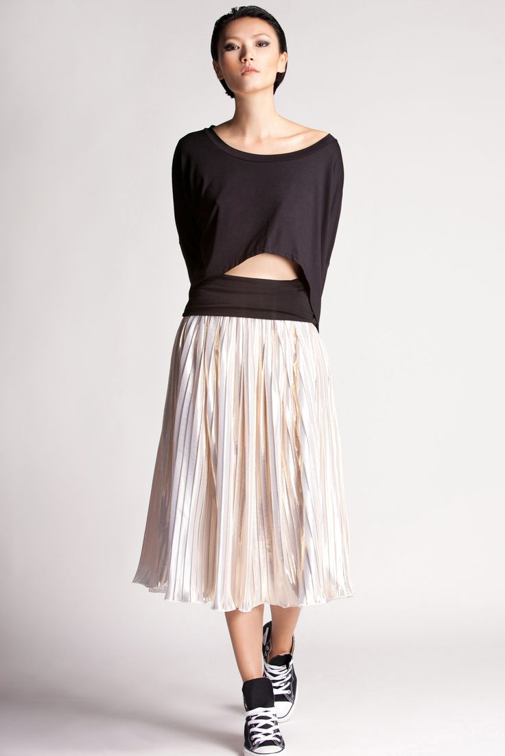 Pleats to please. This skirt has tiny accordion pleats that elegantly sway as you move. Pair it with Rien's cropped sleeves top.