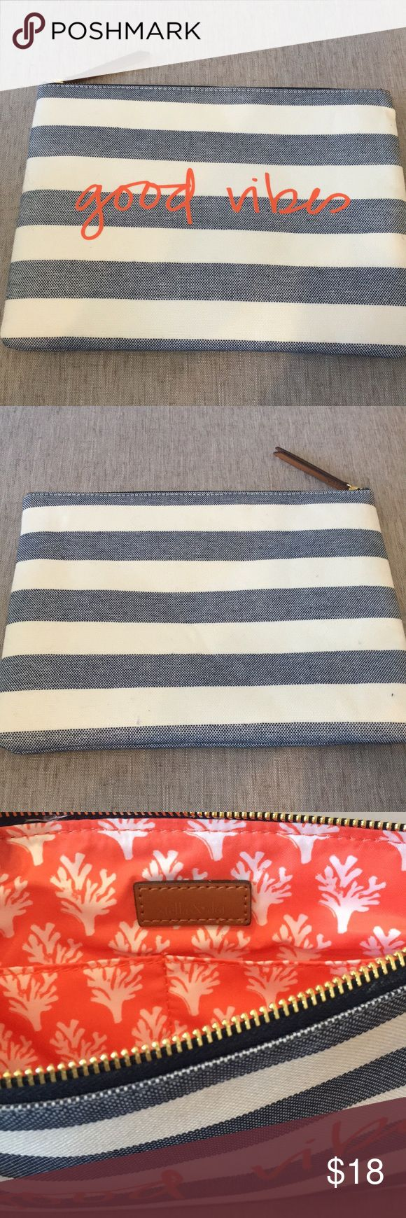 Stella & Dot Clutch Stella & Dot top zipper clutch. Only used once! Blue and white canvas material, with 'good vibes' written in orange on the front. Two inside pockets. There is a small stain on the inside shown in the last photo, but no stains or marks on the outside. Measures 11 inches across and 8 1/2 inches tall. Stella & Dot Bags Clutches & Wristlets