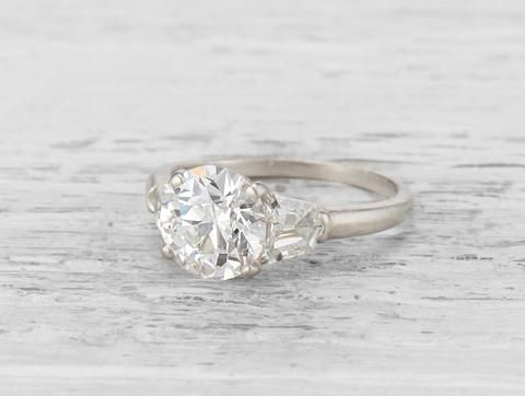 186159130b1d This Vintage Cartier diamond engagement ring is set with a 2.01 carat old  European-cut diamond with GIA certificate stating the diamond is F  color VS2 ...