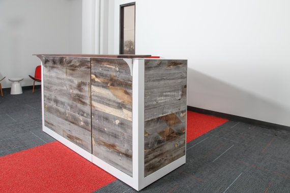 This is our most popular reception desk. This reception counter| welcome desk | front desk was a custom reception desk made from reclaimed wood & cubicle panels. We are a used office furniture dealer. Our mission is to give new life to office furniture and keep it out of the landfills. We have started making beautiful reception desks out of used cubicle panels. We can paint the trim any color to match your needs. The station pictured is 6 6x 83 by 43 tall with 1 pedestal for storage. Howe...