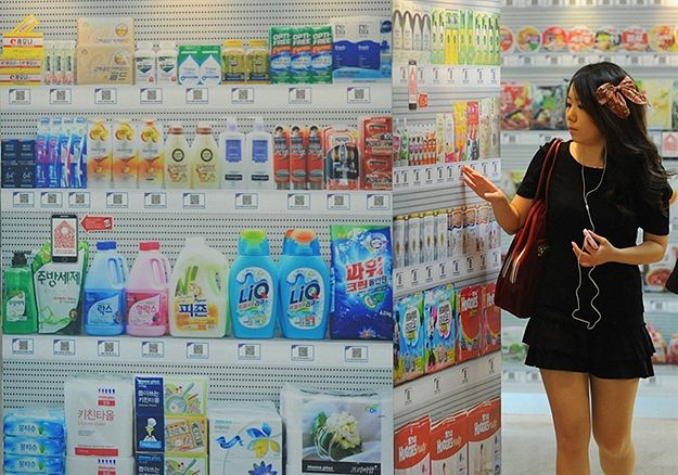 World's first virtual shopping store opens in Korea. All the shelves are LCD screens. Users choose their desired items by touching the LCD screen and checkout at the counter in the end to have all their ordered stuff packed in bags.