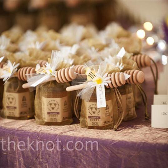 mini honey jars in bags tied w/ mini honey paddle. I'm thinking P's Bees honey. Best natural local honey around.