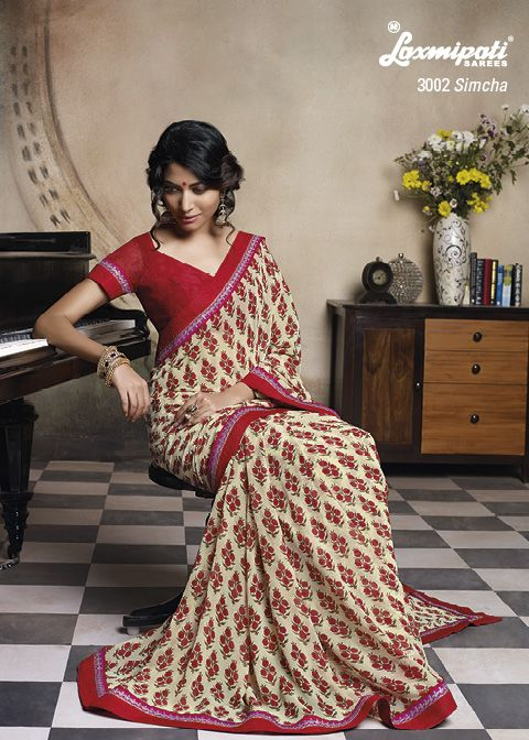 Beautifully Designed Flower Printed Geogette saree with Jari work on its Border.
