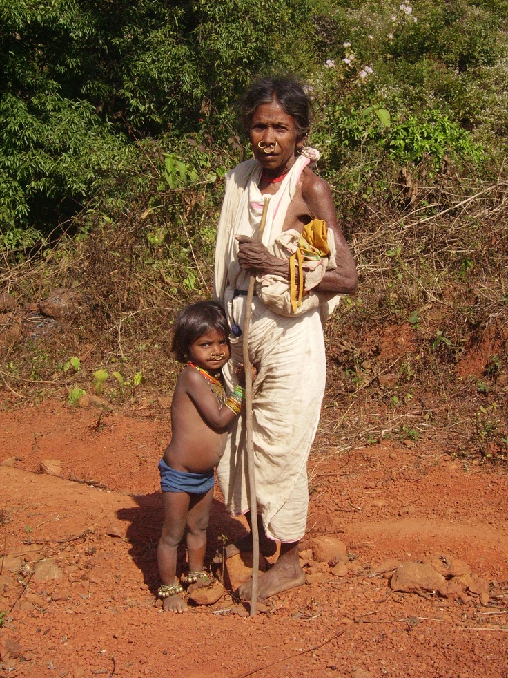 Tribal mother and daughter. First time seeing a caucasian fellow.