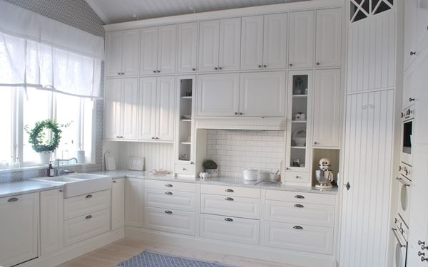 White IKEA Kitchen; beautiful configuration surrounding stove & hood