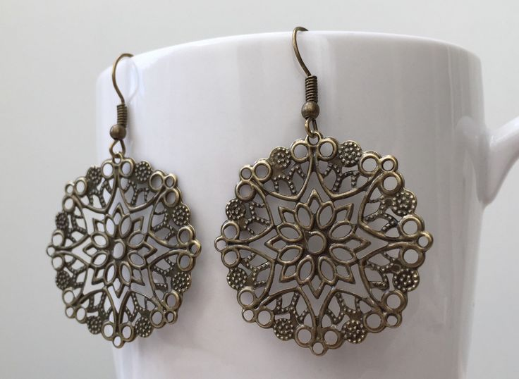 A personal favorite from my Etsy shop https://www.etsy.com/listing/229855354/vintageantique-inspired-bronze-filigree