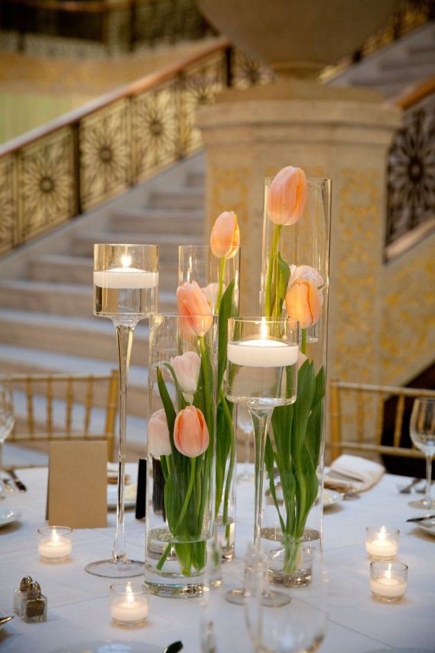 Love to use fresh tulips on the Easter table and this use of tall class cylinders keep them from flopping over. Check your local craft store for the best prices on the glass vase options.