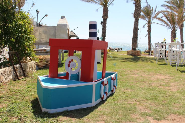 Colorful & happy cardboard boat in the wedding entrance
