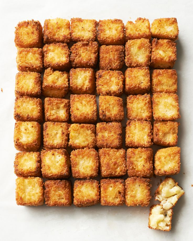 Make way for little squares of heaven -- these fried morsels are sure to be voted most popular at any party. You can (and should) prepare the stovetop macaroni and cheese a few days ahead, since it will firm up in the refrigerator, for easier cutting. Then follow a two-step breading process, using panko instead of regular breadcrumbs for a crust that's crisp yet light. Don't be put off by the yield; the squares fry quickly, in three or four batches, and you can reheat replenishments over…