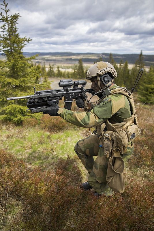Recruits with The Norwegian Army's Manoeuvre School's Mechanized Company Group (KESK) during a live fire exercise at Rena Military Base. June 4, 2015.