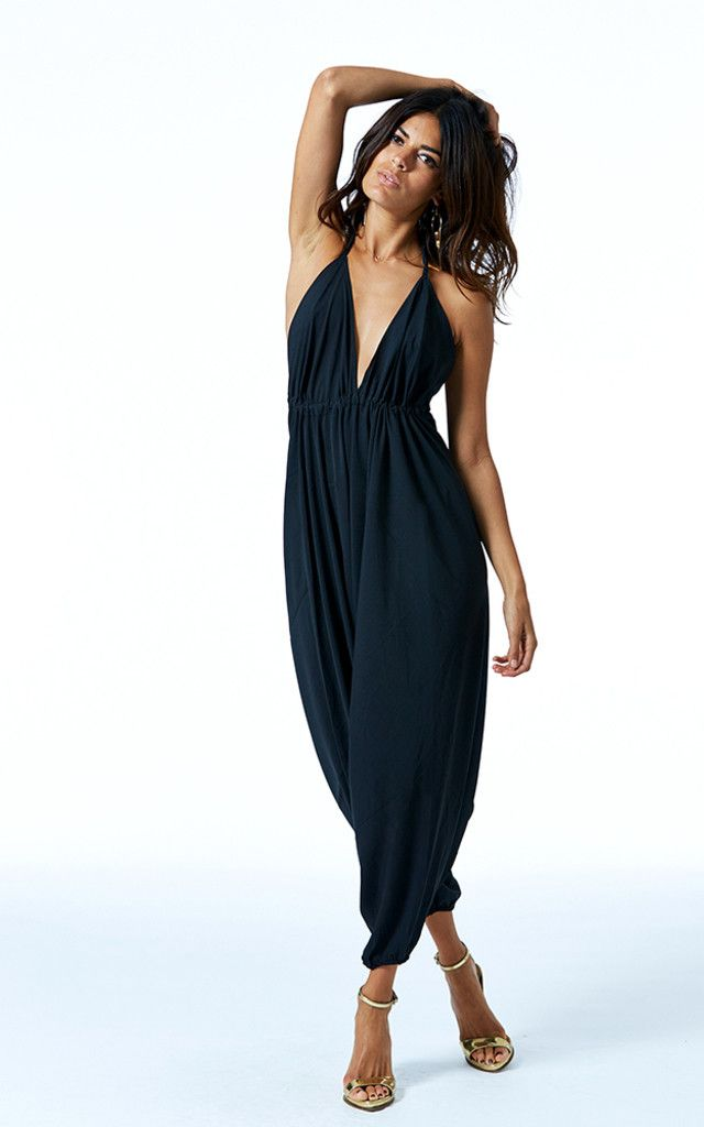 Super versatile genie jumpsuit. Pair with sandals for lazy summer days, festivals, and holidays, or dress it up in the evening with killer heels and statement jewellery. The bust area is fully adjustable and ties at the neck and back by drawstring so you can fit to flatter. Shop now.
