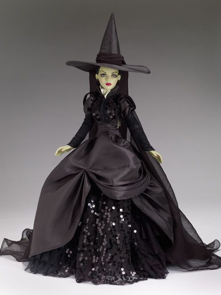 Wicked Witch of the West #pinned from our 75th Anniversary Wizard of Oz Collection - $249.99 #dollchat ^kv  This villainess reveals a lovely fashion take on this wicked beauty, with delicate hand-painted facial detailing, deep brown painted eyes behind lush lashes, thick rooted raven hair and an outfit to die for...just ask her sister!