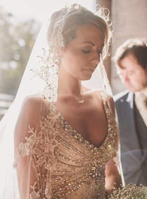 Jewel-encrusted bodice on the champagne wedding gown. Gorgeous! You clearly won't need much, if any jewelry with that stunner of a dress. ^_~ <3