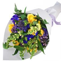 A pretty mixed bouquet of bright sunshine-yellow and dark purple flowers. Order from http://www.flyingflowers.co.nz/sunshine-bright